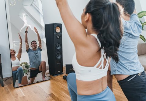 Couple working out in front of the VAHA fitness mirror.