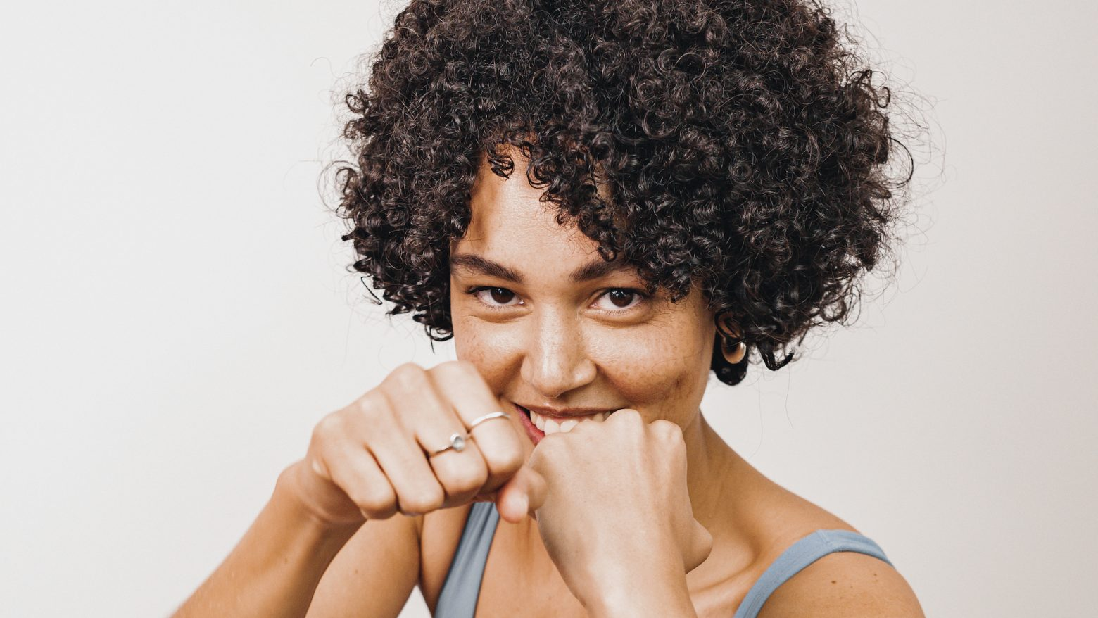 Woman holding her fists up in a boxing position.